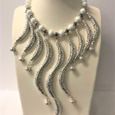 Intricate tubes, opaque white crystals and electroplated lava beads £85