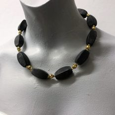 Black Onyx with gold plated skulls – £45